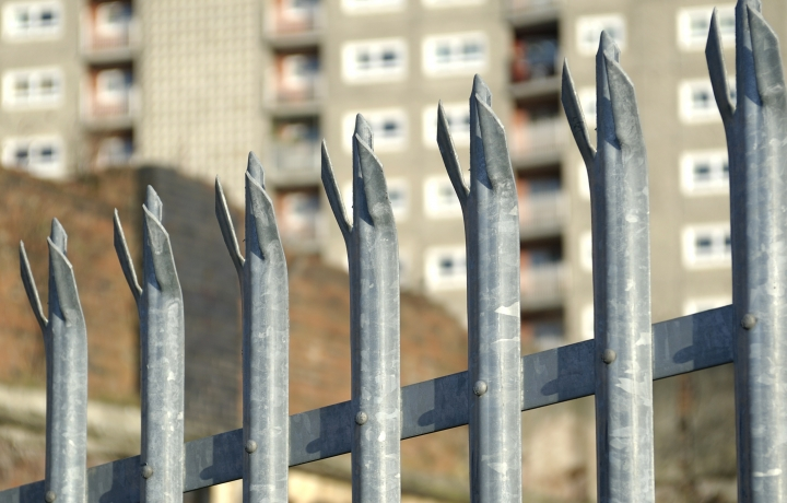 Jagged metal fence in a council estate