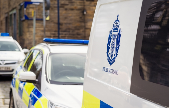 Photo of Police Scotland vehicles on cobbled street