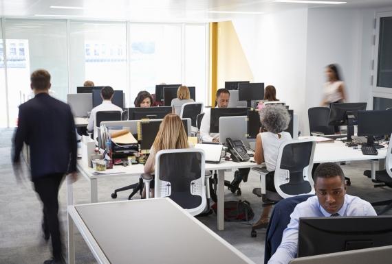 Workers in an open plan office