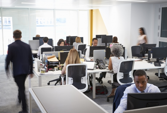 Workers in an open plan office