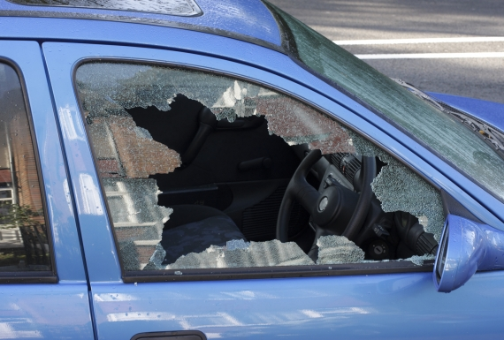 Car window smashed by car thief